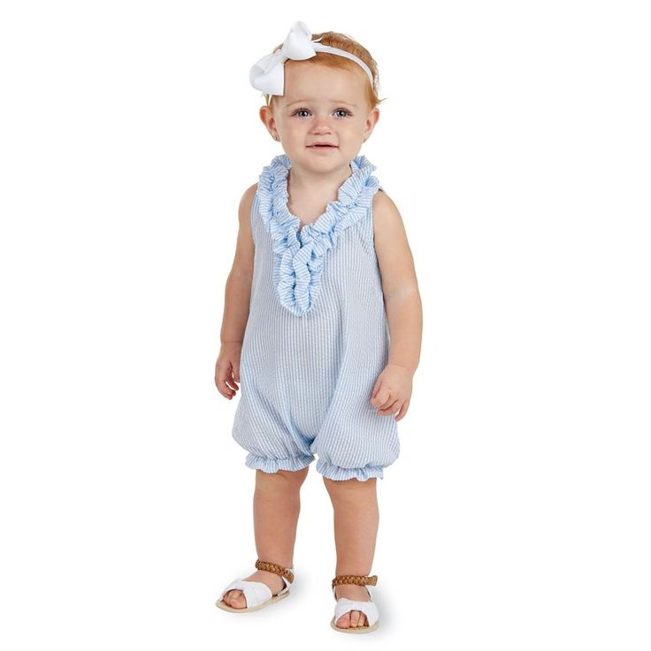 Blue seersucker romper features ruffle neckline and ruffle leg opening. Inner leg snap closure. #MudPieGift