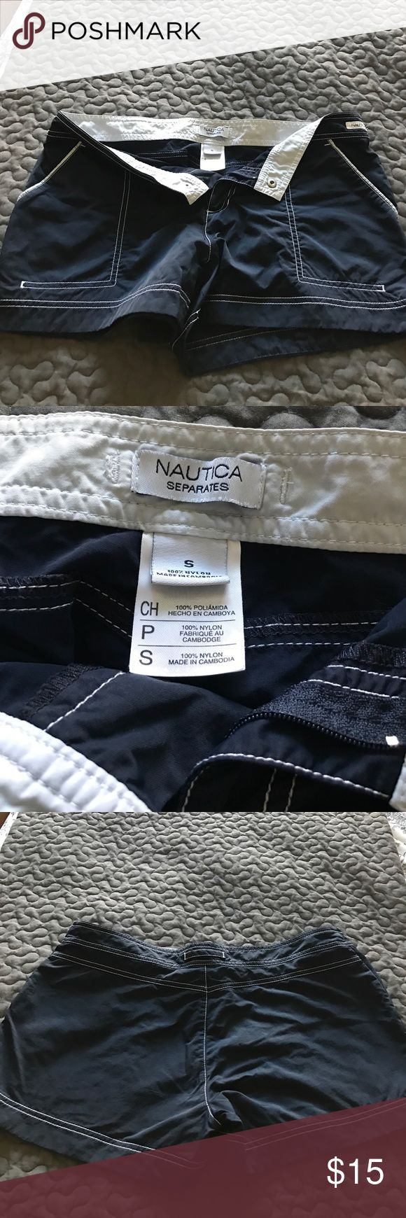 Nautical women's board shorts size small Nautical women's swim board shorts - dark blue and white trim.  Size small. Nautica Swim