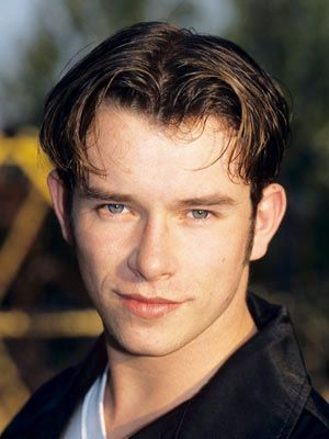 """STEPHEN GATELY (d 2009) grew up Catholic in relative poverty in Dublin.  He formed the band Boyzone, which had six #1 hits in the UK.  In 2000, he voiced Blackavar for a television series of Watership Down, in 2001 he had a cameo in Absolutely Fabulous, in 2002 he was Joseph in the Amazing Technicolor Dreamcoat, & in 2006 he was The Scarecrow in the Wizard of Oz.  In 2008, the video for Boyzone's single """"Better"""" was attacked by a Presbyterian church for showing two men embracing."""