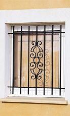 Grille de fenêtre en fer forgé Voltaire