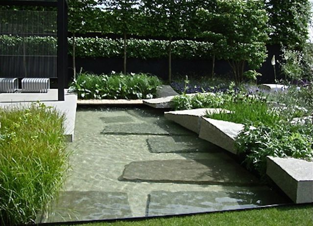 large stone slabs, would like to see some just breaking the surface . Ulf Nordfjell Garden Design Gardenista