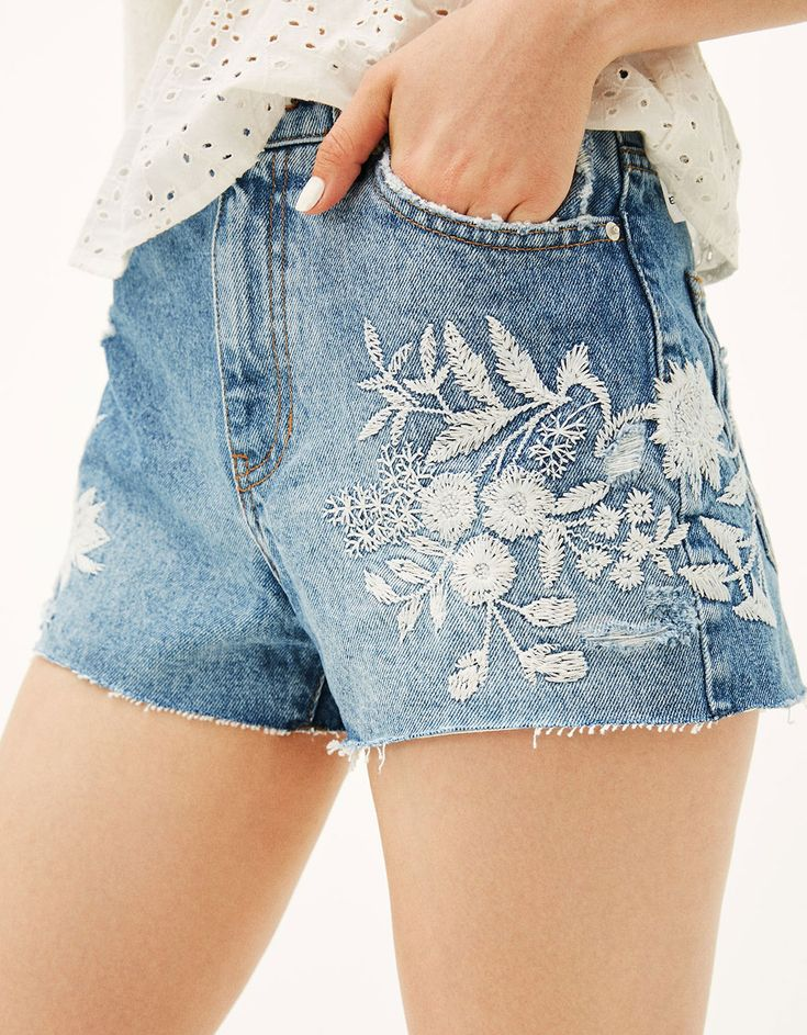 Denim shorts with white embroidered flowers. Discover this and many more items in Bershka with new products every week
