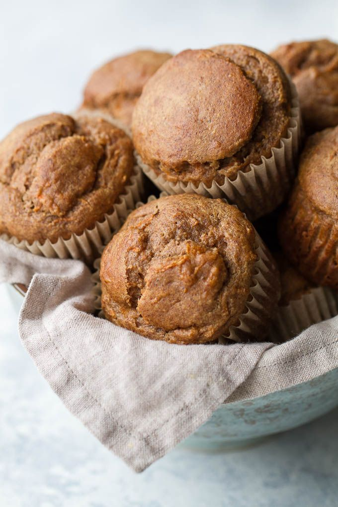 Flourless banana carrot muffins that are so tender and flavourful, you'd never know they were made without flour, oil, or refined sugar. Gluten free and made with wholesome ingredients, they make a healthy and delicious breakfast or snack | runningwithspoons.com #glutenfree #healthy #recipe