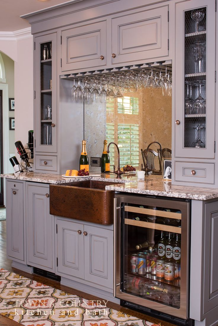 Wet bar by Town & Country Kitchen with Native Trails apron front bar sink