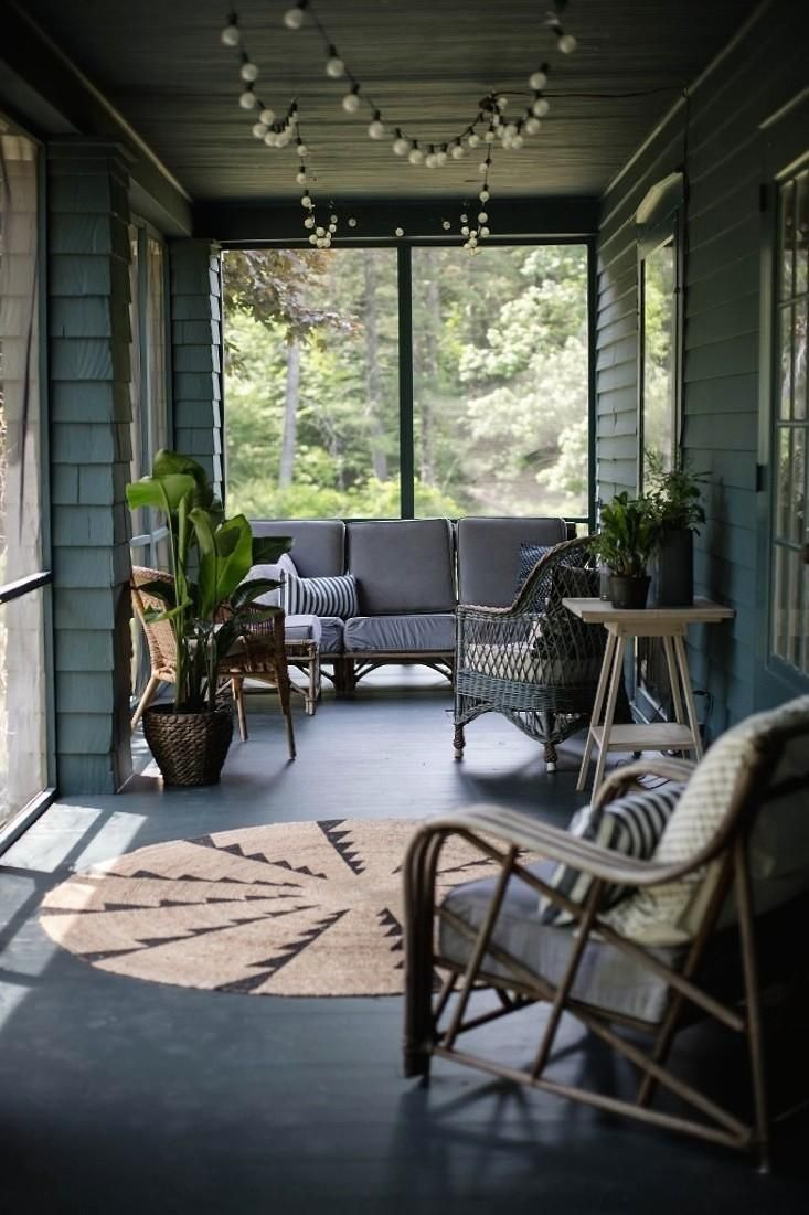 Soothing hues enhance the appeal of this screened porch in upstate New York.