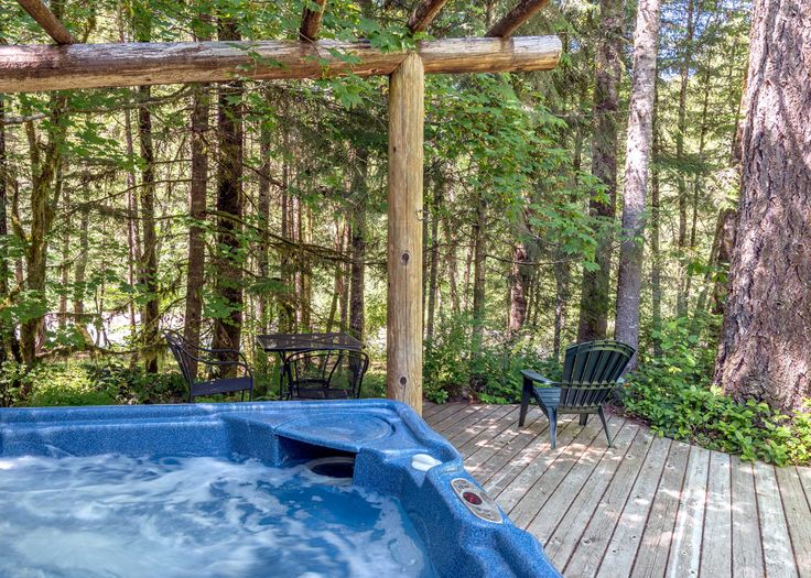 You can see the Sandy River while sitting in the hot tub at Pine River Cabin.
