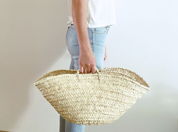 Our baskets are entirely handmade, woven with natural palm leaf fiber harvested from the countryside in the Algarve. The perfect shopping basket, beach bag, picnic basket; Or a practical storage ...