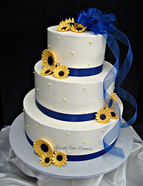 Elegant White Buttercream Wedding Cake with Royal Blue Ribbon and Yellow Daisies by Graceful Cake Creations, via Flickr