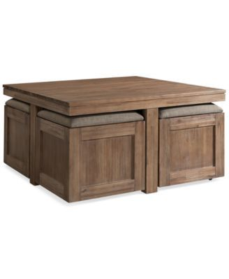 Champagne Cube Coffee Table with 4 Storage Ottomans $899.00 Well seated! Tucked under this solid acacia wood cocktail table are four storage ottomans that are perfect for pulling up a seat or kicking up your feet. A wirebrushed finish runs through this set to emphasize the natural beauty of each piece.