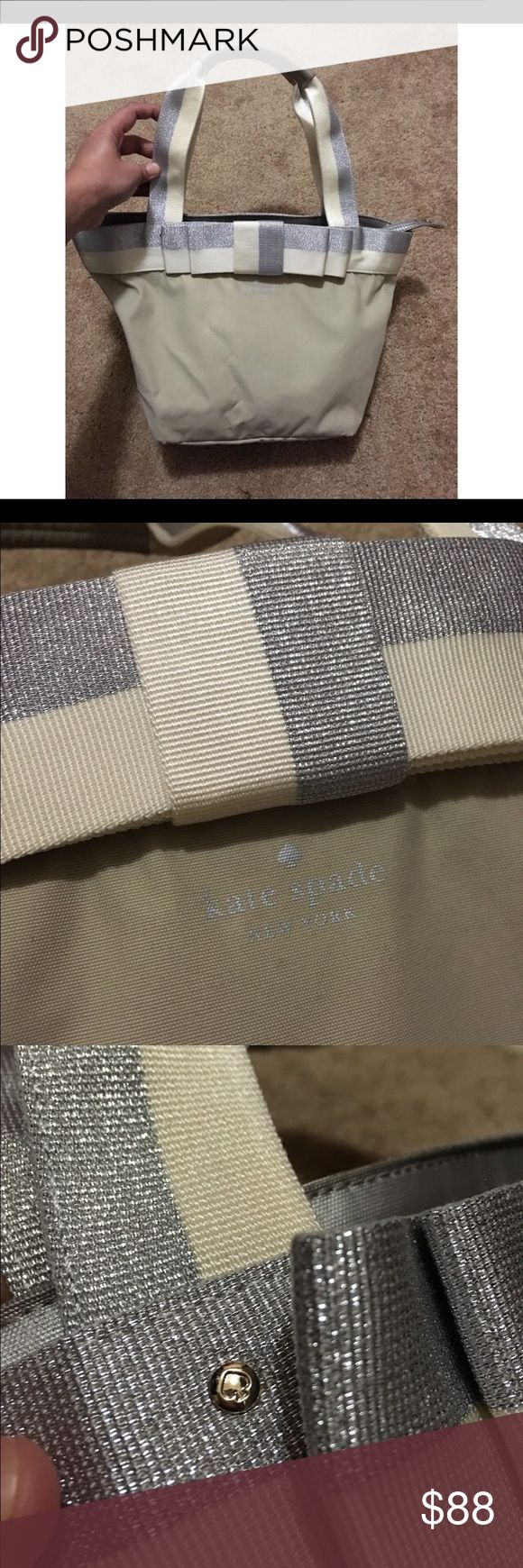 Kate Spade NY Barrow Street Garri Bow Tote Bag Kate Spade New York Barrow Street Garri Bow Beige/ Silver Tote Bag; Used; Condition 9.5/10; ONLY FLAW: Last photo shows scuff marks inside zipper kate spade Bags Totes