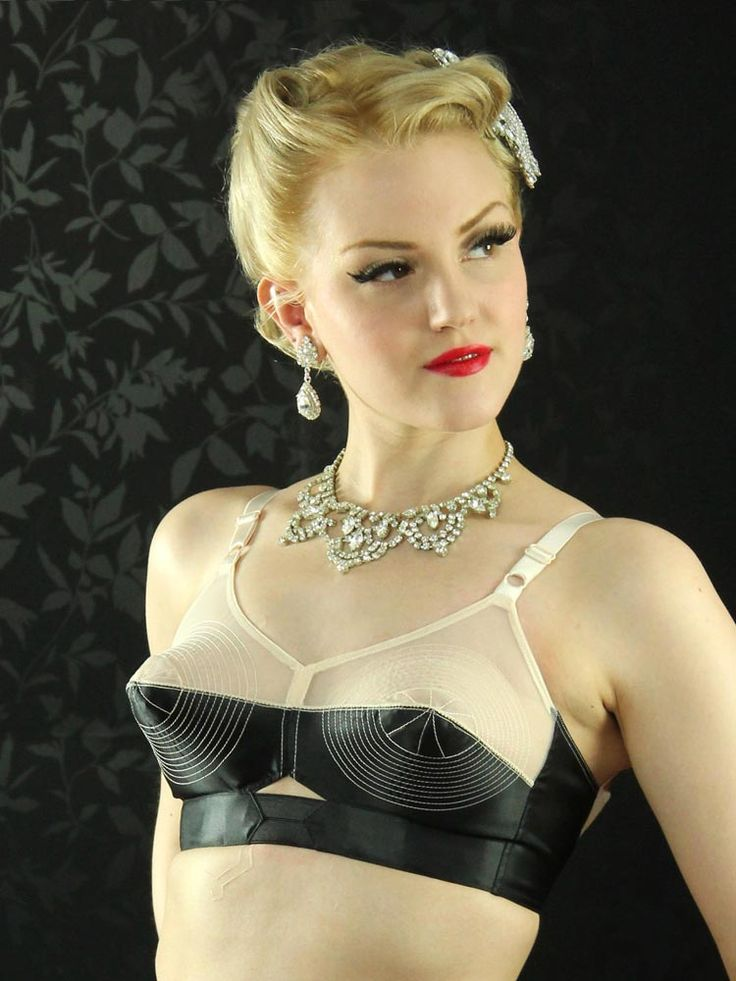 Striking two-tone bullet bra combining black satin with sheer peach organza. Features our signature circular stitching on the cup., Unlike modern bras,  which push the breasts inwards and upwards,  the Marlene Bullet Bra gently coaxes your breasts into the perfect 1950s conical shape. , What Katie Did were the first company to revive the bullet bra over a decade ago,  adapting an