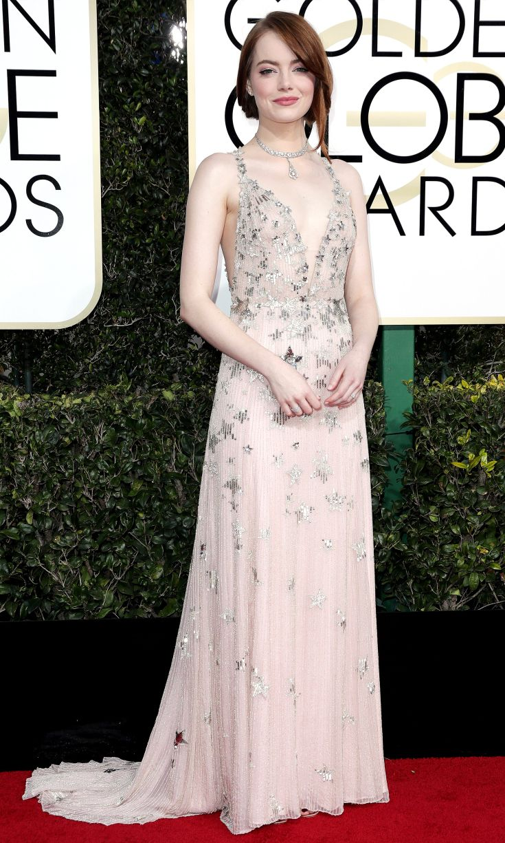 2017 Golden Globes: Emma Stone is wearing a white Valentino gown with a plunging neckline and stars. Gorgeous from head to toe! I like the star design on the dress. Emma always goes for amazing looks on the red carpet!