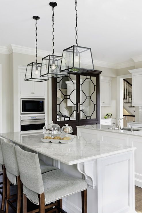 Caden Design Group Gorgeous Two Tone Kitchen With White Shaker Kitchen Cabinets Paired With