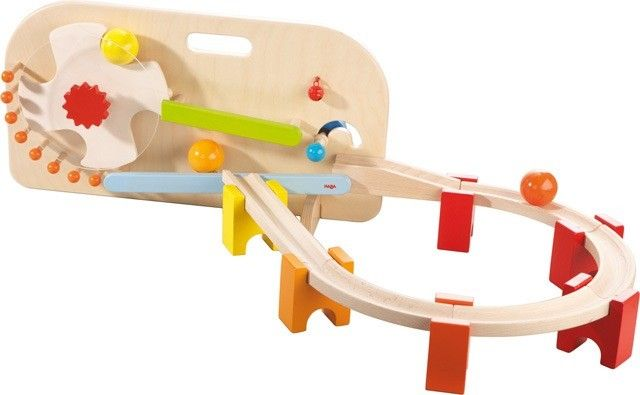 Made from solid beech wood in Germany, just place the large balls in the conveyor wheel, and then turn the easy-to-hold dial. Watch as the cheerfully-coloured balls get churned out one-by-one onto the track, complete with a little tinkle from the bell #haba #balltrack #toddler