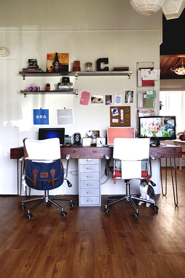 Love this long desk that accommodates two people as a home office, freelancer workspace idea.