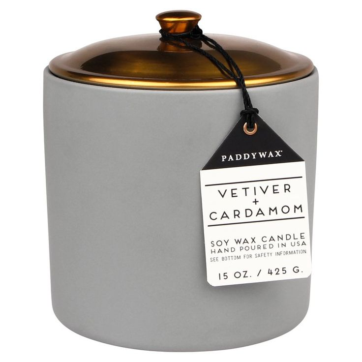 Paddywax® introduces the Scandinavian inspired Hygge Candle, meaning 'coziness' in Danish. Curl up with a good book around this vetiver & cardamom scented candle, packaged in a matte ceramic vessel complete with a copper lid. Reuse the trendy vessel once the wax runs out to store trinkets or to hold a succulent. Soy Wax. Cotton Wick. Hand-poured in Nashville, TN, USA. 15 oz. CAUTION: Burn within sight, keep out of reach of children and pets, keep away from things that catch fire, place on…