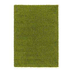 Area rug that looks like the grass of a field.  Perfect for they boys baseball themed room.