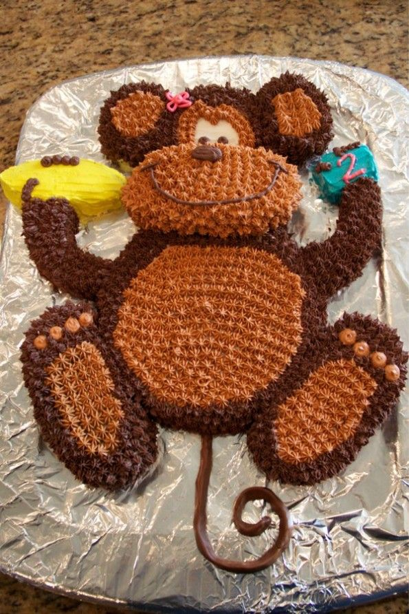 "I recently made this monkey cake for a special 2 year old in my life.  She loves monkey's and is constantly singing ""No More Monkey's Jumping On the Bed.""  It"