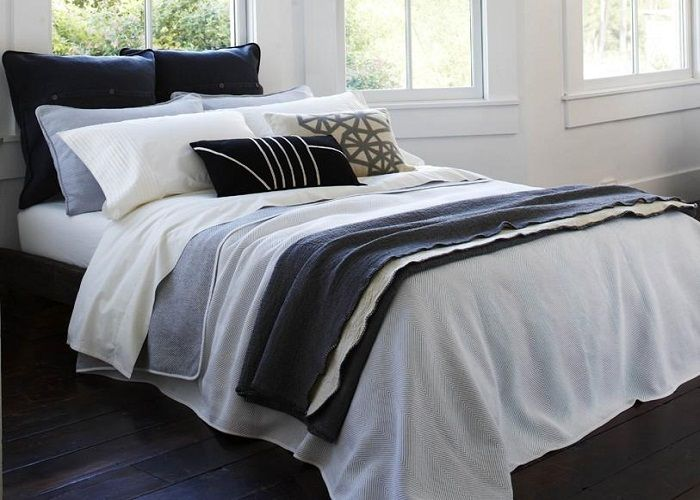 Disposizione cuscini classici con cuscini piccoli decorativi