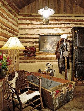 Bathroom in Fredericksburg, Texas.  I like the old cowboy gear hanging on the hat rack.