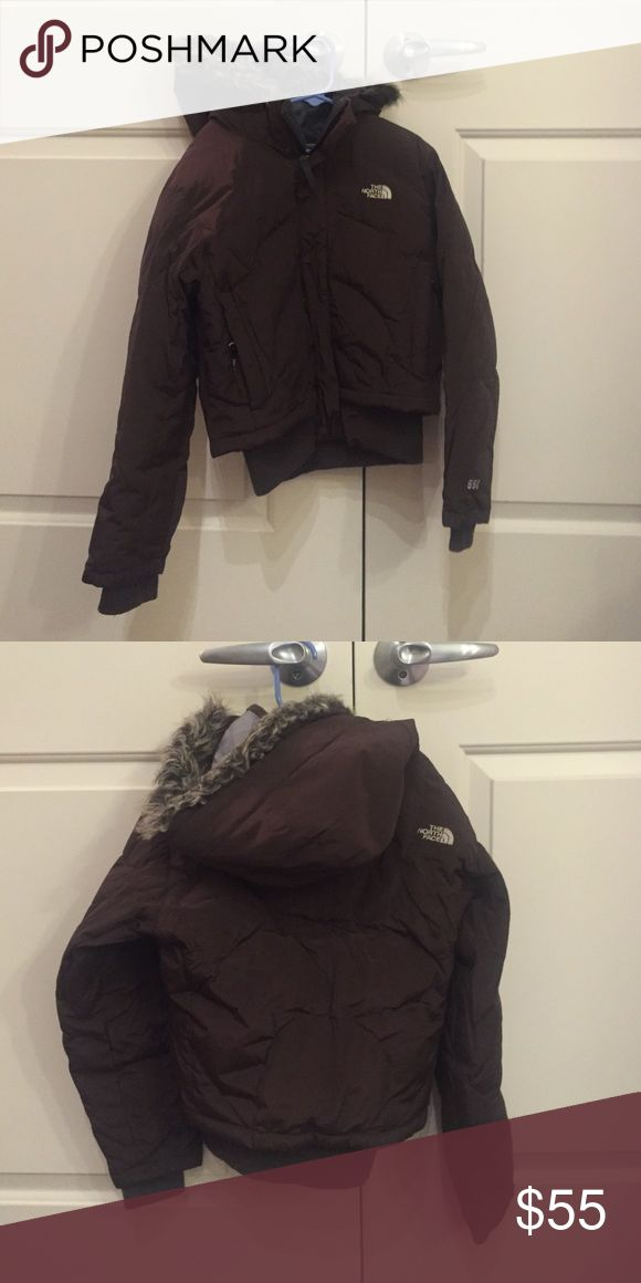The North Face Girls winter coat  size medium. The North Face girls brown winter coat with hood size  medium. 550 fill count and very thick and warm. Great condition.  Smoke free home. The North Face Jackets & Coats