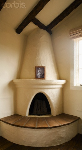 Spanish Style Fireplace © Lived In Images/Corbis
