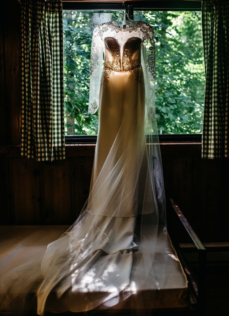 Wedding dress in a cabin. These photos show you how to have the perfect camping wedding. #camping #wedding