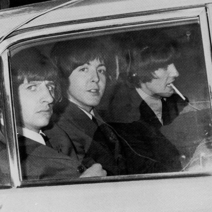 13th April 1965. The Beatles interviewed in the back of a radio car for the BBC radio show 'Pop Inn'.