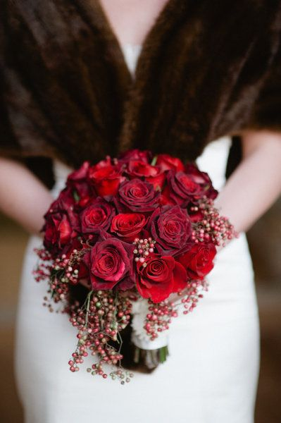 Round style with slight drape.  Variation of darker to brighter red roses with pepper berry.