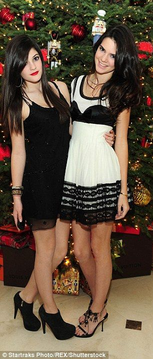 Come so far: Kendall and Kylie Jenner at a Beverly Hills event in March, left, and celebrating Christmas in 2009 looking normal Girls suburb