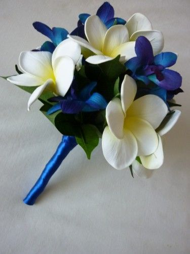 Blue orchids and white plumeria.  This one is fake and not full enough... But I think these are the two main flowers I want!