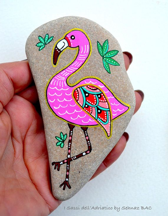 Hand Painted Stone Flamingo Beach stone with hand-painted designs in acrylics © Sehnaz Bac 2017 I paint and draw all of my original designs by free hand with acrylic paints, small brushes or paint pens with extra fine tip. I use also different inks. No stencils are used. All