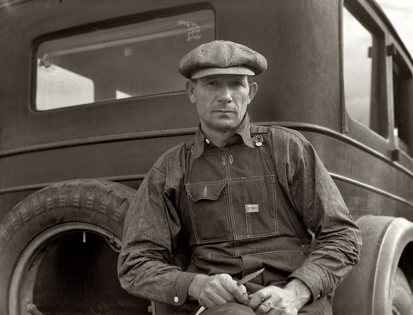 "November 1936. ""Drought refugee from Polk, Missouri. Awaiting the opening of orange picking season at Porterville, California.""  Dorothy Lange:"