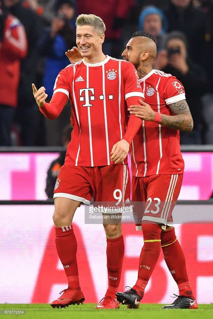 Robert Lewandowski of Bayern Muenchen celebrates after the scored his teams third goal to make it 3:0 with Arturo Vidal of Bayern Muenchen (r) during the Bundesliga match between FC Bayern Muenchen and FC Augsburg at Allianz Arena on November 18, 2017 in Munich, Germany. (Photo by Sebastian Widmann/Bongarts/Getty Images)