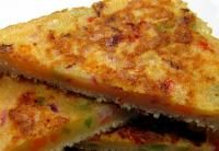 Malai and Suji Toast recipe.  Fresh bread slices,medium size1 cup malai½ cup semolina/ suji1 tomato chopped1 onion chopped1 small green capsicum, choppedRed chilli powder to tasteSalt to tasteOil to cook