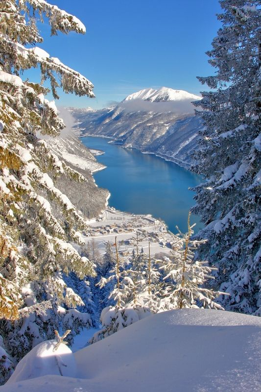 Achensee in winter, Austria. Lake Achen is north of Jenbach in Tyrol, Austria. An alpine lake, water temperature is accordingly low, rarely above 20 °C. Its size and wind conditions make it suitable for windsurfing. (V)
