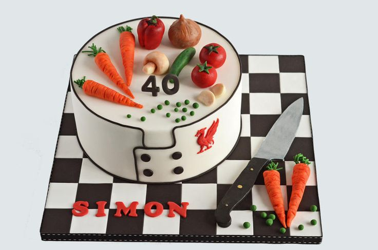 """Chef Cake -- This was a 9"""" vanilla cake filled with vanilla buttercream and strawberry jam and covered in white chocolate ganache and then sugarpaste. It was ordered for a surprise party for a chef who supports Liverpool."""