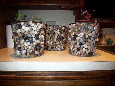 #DIY pebble flower pots. Cheap black planters + Liquid Nails + dollar store pebbles = cute.