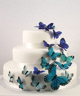 Really like this, but green butterflies, and thin black ribbon around the cakes
