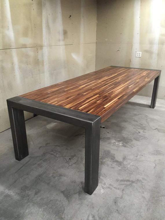 Handmade walnut and steel dining room table. A new design featuring a modern walnut table with industrial beam accents. Finished with a
