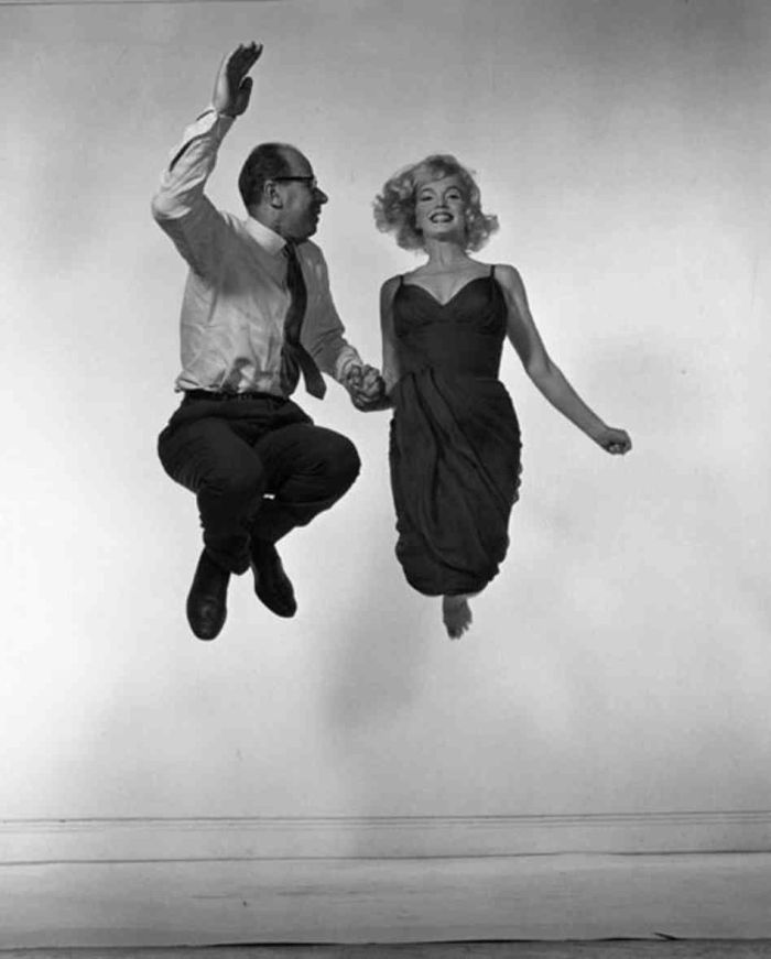 """philippe halsman marilyn monroe  jump photo 1954. When you ask someone to jump, Halsman said, """"the mask falls, so that the real person appears."""" The idea of having people jump for the camera can seem like a gimmick, but it is telling that jumpology shares a few syllables with psychology. As Halsman, who died in 1979, said, """"When you ask a person to jump, his attention is mostly directed toward the act of jumping, and the mask falls, so that the real person appears."""""""