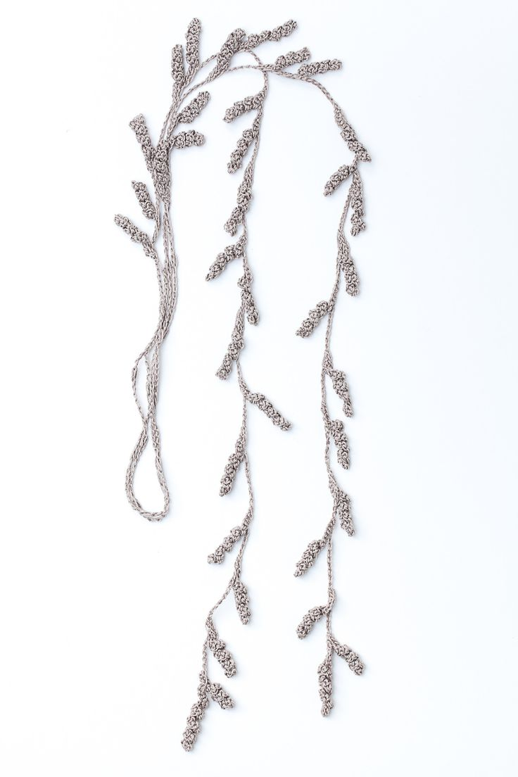 Inspired by the subtle tendrils of a vine, this lariat-style necklace is composed of delicate crochet spirals that drape beautifully. Offered...