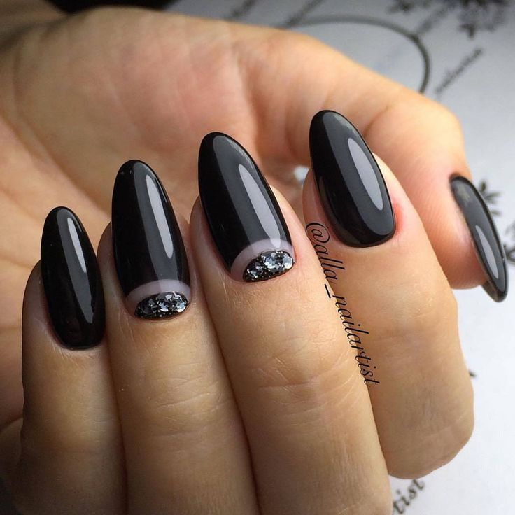 Black manicure always looks stylish and actual. It emphasizes fine your individuality. The long oval nails add your hands some ...