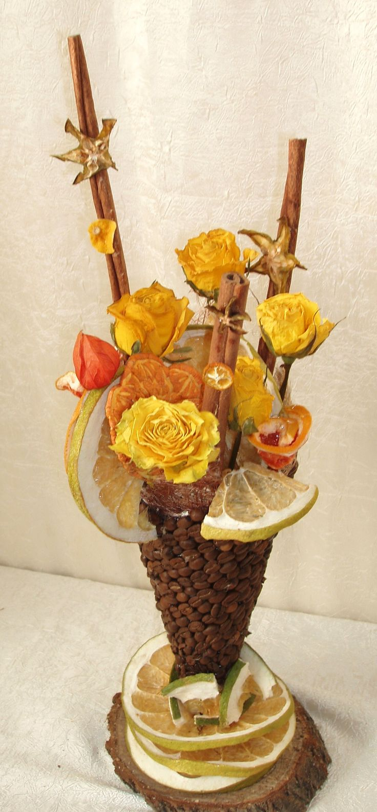 """a """"coffee"""" vase with dried flowers"""