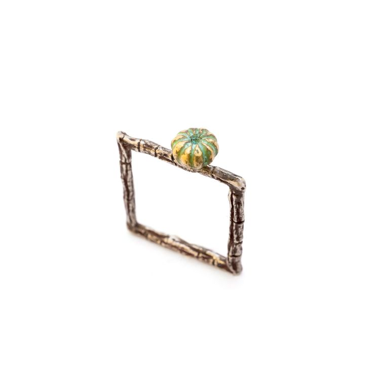 Oxidized Silver Square ring made from a tree branch, with a tree fruit in oxidised bronze placed at the top of the ring.