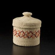 This is an example of an Aleut (Unga) basket made by Sharon Kay and shown on the Spirit Wrestler Gallery Site.