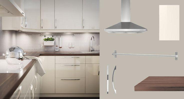 AKURUM kitchen with ABSTRAKT yellow-white high-gloss doors/drawers and PRÄGEL walnut effect countertop