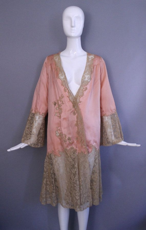 Glamorous baby pink and lace silk dressing robe/kimono from the late 1920s. Ecru, antique floral lace at the bell sleeves, down the front, and at