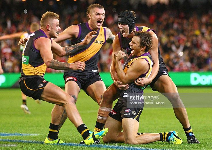 Sam Lloyd of the Tigers is congratulated by Dustin Martin, Ben Griffiths and…