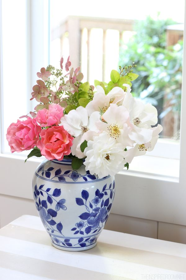 Blue and white vase with pink and white flowers